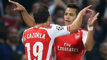 Arsenal's Alexis Sanchez (right) celebrates with team-mate Santi Cazorla after putting his side ahea