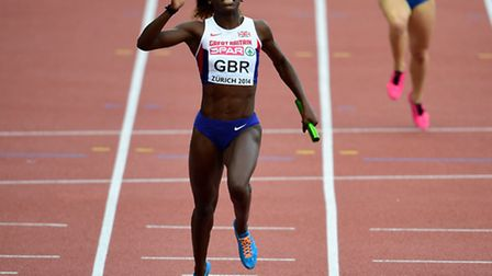 Great Britain's Desiree Henry crosses the line to win the women's 4x100m relay final during day six