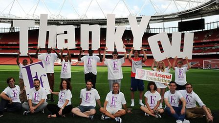 Arsenal footballer Tomas Rosicky with charity members at the Emirates Stadium