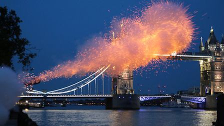 The Honourable Artillery Company fire a 21-Gun twilight salute at the Tower of London as part of the