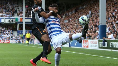 Queens Park Rangers' Armand Traore (right) battles for possession