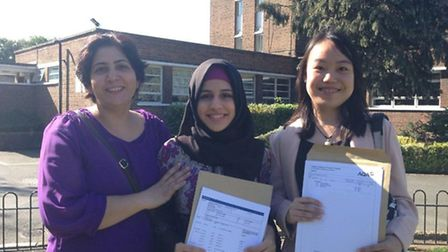 Ruoqiao (right) and Marjon (2nd from right) from Preston Manor School achieved 14 A* and 7 As betwee