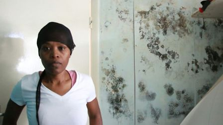 Donna Rose suffers in her damp-riddled flat (pic credit: Angela Blake)