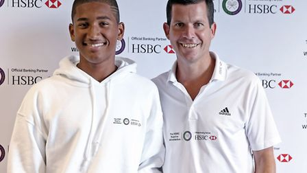 Tim Henman with Capital City Academy student Zachary Phillips during the HSBC Road to Wimbledon. (Ph