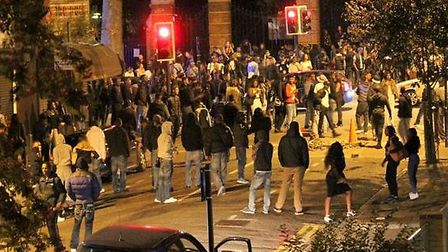 Revellers flood the streets around Finsbury Park at illegal rave - photo by Jono Kenyon