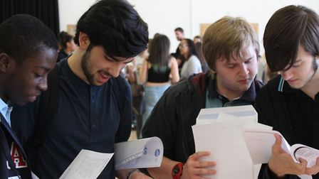 Pupils at St Mary Magdalene open their results. By Max Hodgkinson