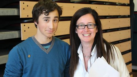 Edmund Adonis, 13 A*s, with headteacher Vicky Linsley. By Max Hodgkinson