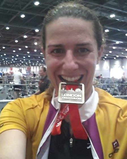 Melanie Cohen with her London Triathalon medal