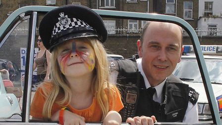 Kirsty Aston, 6, with Pc Phil Clark at the open day in June. Pic:Tony Gay