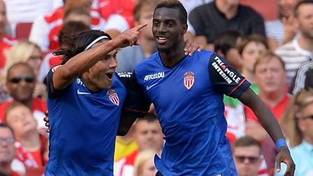 AS Monaco's Radamel Falcao (left) celebrates with team mate Tiemoue Bakayoko after he heads the open
