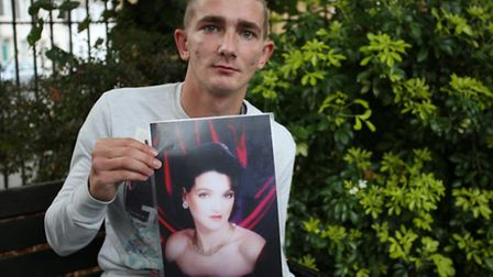 Joe Lillington with a picture of his mum Toni Skillington who died and Joe is sueing the ambulance s