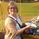 Caroline Russell with fragments of the Highbury Grove mural that she found in a skip