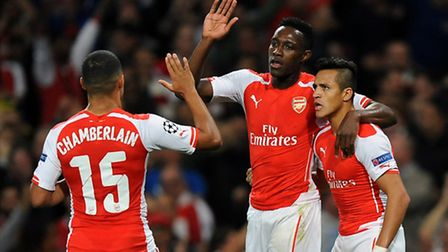 Arsenal's Danny Welbeck celebrates scoring his side's first goal against Galatasaray with Alexis San