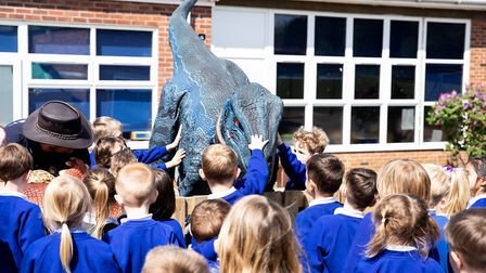 Children welcomed some prehistoric visitors as Dell Primary School's new Early Years play area was o