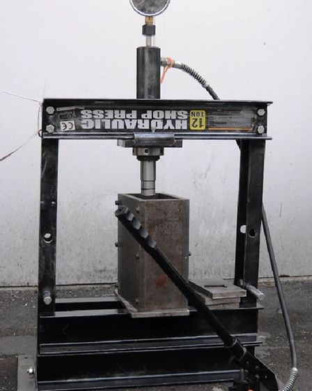 A hydraulic press discovered by police