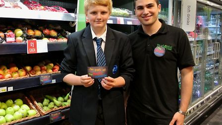 John Deboo of St Mary Magdalene Academy receiving his free fruit with Francesco Puglisi from Budgens