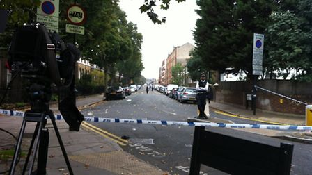 Shepperton Road has been taped off by police