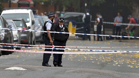 Police at the scene in Shepperton Road Pic: John Stillwell/PA Wire