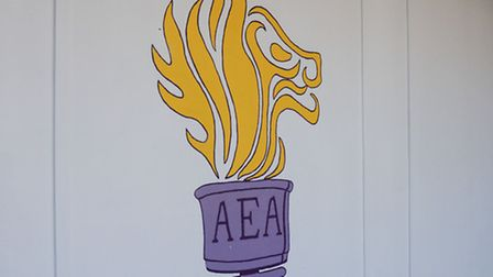 The new school logo was painted in the main courtyard