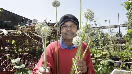 Dr Harekrishna Bhowal with his giant spring onions (Pic credit: Jan Nevill)