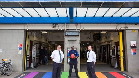 TfL staff show their support with a rainbow zebra crossing