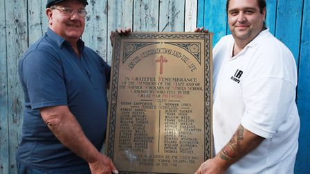 Westley Davis, right, and Brian Southwood found a WWI plaque in a car boot sale.