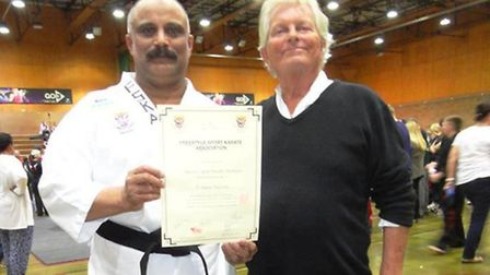 Syed Haider Mannan with Peter Lewis, president of Free Style Karate