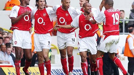 Arsenal's Robert Pires (second left) celebrates with team-mates after scoring the second goal agains