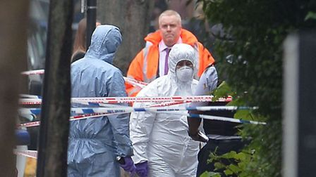 Forensics officers at the scene in Shepperton Road Pic: John Stillwell/PA Wire