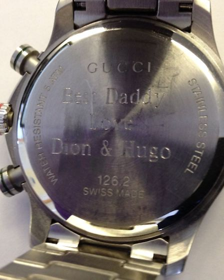 The Gucci watch has a distinctive engraving on the rear of the watch reading 'Best Daddy love Dion a