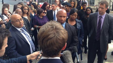 Emmanuel Flavius, front of the crowd, described the verdict as �the best ever.�