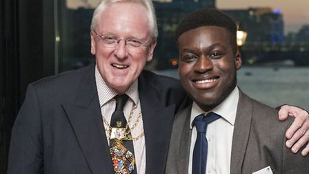 Alderman Andrew Parmley awards David Annor with the Highly Commended Trainee of the Year Award at th