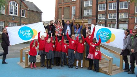 Cllr Andy Hull joins headteacher Harsha Patel, staff and pupils at Copenhagen Primary School to cele