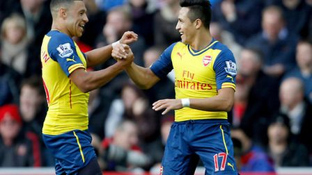 Arsenal's Alexis Sanchez (right) celebrates his opening goal at Sunderland with Alex Oxlade-Chamberl