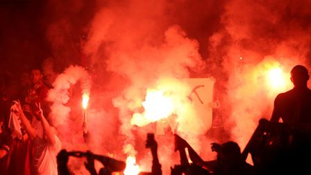 Galatasaray fans with flares in the stands - Pic John Walton