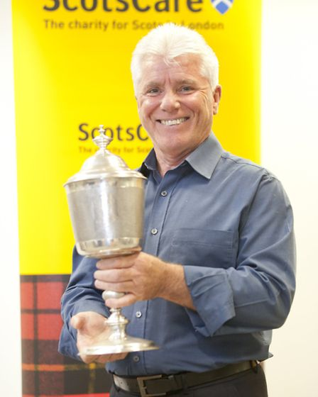 CEO of Scotscare Willie Doherty holds the 17th century cup of the charity.