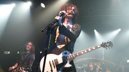 Justin Hawkins, front, from The Darkness is auctioning off stage clothes on ebay (Pic credit: PA)