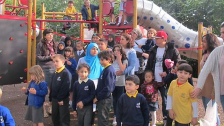Children celebrating the opening of the new playground in Ibert Street, Queen's Park.