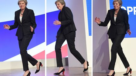 Theresa May dances on stage before her party conference speech (Image: PA Wire)