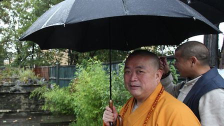 Grandmaster Shi Yong Xin is greeted by some traditional British weather