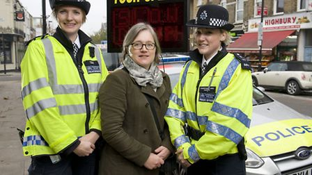 (L-R) Constable Rebecca Masters, Councillor Caroline Russell & Constable Lauren Cairns during a poli
