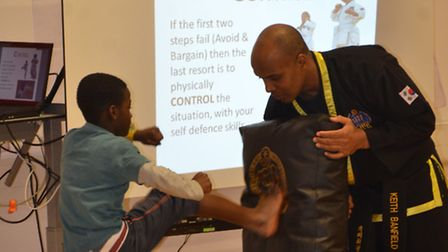 Martial art moves - Wembley children learn Choi Kwang Do in anti bullying workshops