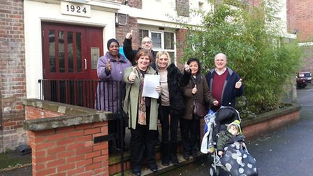 MP Emily Thornberry (front) with Warren Levy (back) and other residents of Sutton Dwellings