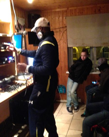 DJ Gussy standing up for Stonebridge with children from the adventure playground