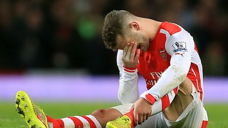 Arsenal's Jack Wilshere reacts after suffering an injury during the game against Manchester United