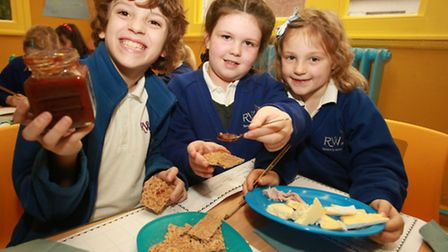 Reuben Elliot, left, Baylie Melhad, and Ava Walters, of Rosemary Works School, taste their own-made