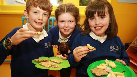 Ollie Woollard, left, Baylie Melhad, and Lily Hamil, of Rosemary Works School, taste their own-made