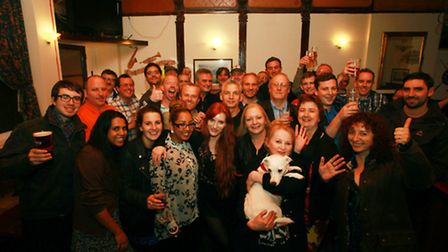 Regulars and staff celebrate the White Lion re-opening after the fire, including Philomena Curtin an