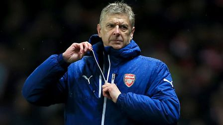 Arsenal manager Arsene Wenger looks unimpressed by his side's defensive display against Anderlecht