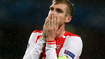 Arsenal's Per Mertesacker looks dejected at the end of the game